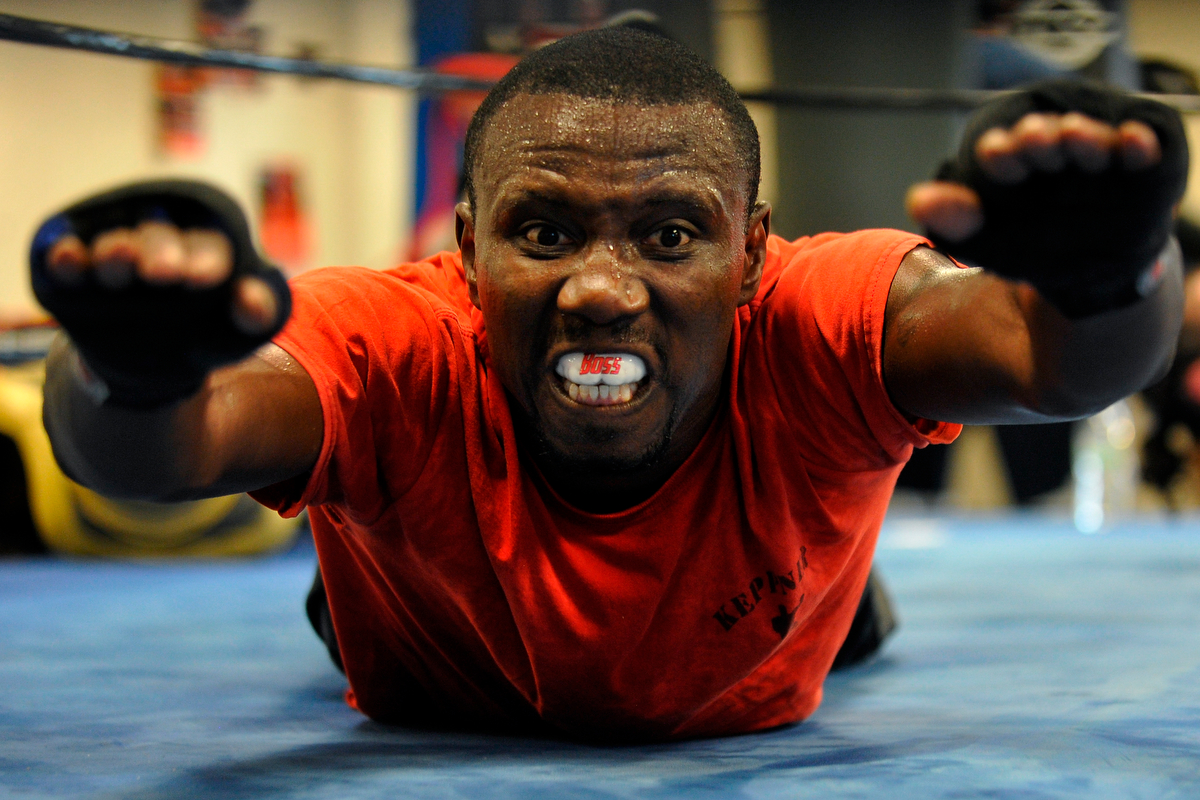 Tim Hall works out during a class at Kepner Boxing on Wednesday, Aug. 13, 2014, in Athens, Ga. (AJ Reynolds/Staff, @ajreynoldsphoto)
