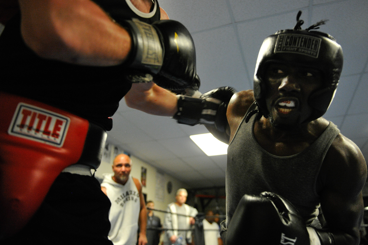 Tim Hall lands a punch while sparring during a fundraising event at Keppner Boxing on Saturday, Oct. 25, 2014, in Athens, Ga. The event commemorated the 10th anniversary of Tim Hall's first professional fight and all proceeds benefitted Project Safe. (AJ Reynolds/Staff, @ajreynoldsphoto)