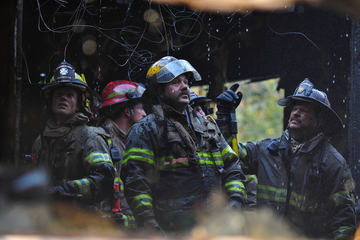 Athens Clarke County firefighters work inside a house that caught fire off Hull Road in Athens, Ga., Friday, December 7, 2012. (AJ Reynolds/The Athens Banner-Herald)
