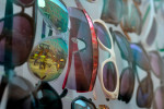 Construction workers are reflected in a display of sunglasses at Dynamite Clothing while working on Jackson Street between Broad Street and Clayton Street on Tuesday, July 15, 2014, in Athens, Ga. This block of Jackson Street will remain closed for two weeks. (AJ Reynolds/Staff, @ajreynoldsphoto)