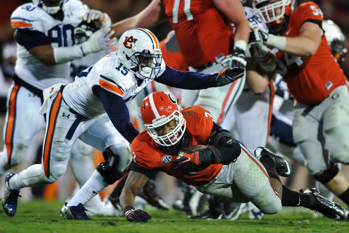 Georgia running back Todd Gurley tears his ACL while running the ball during the fourth quarter of an NCAA college football game between Georgia and Auburn on Saturday, Nov. 15, 2014, in Athens, Ga. The injury will end Gurley's season. (AJ Reynolds/Staff, @ajreynolds)