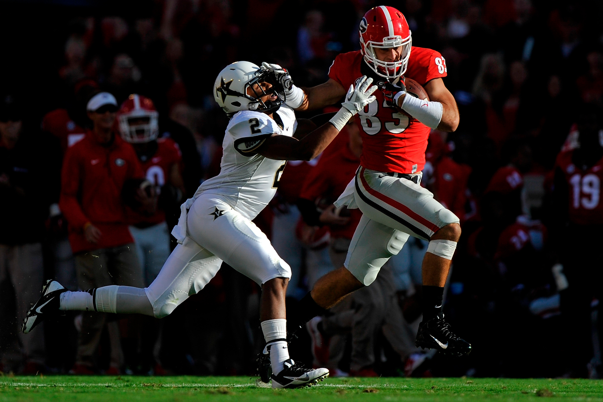Georgia tight end Jeb Blazevich (83) attempts to break a tackle from Vanderbilt defensive back Tre Tarpley (2) after catching a pass from Georgia running back Todd Gurley (3) during an NCAA college football game between Georgia and Vanderbilt on Saturday, Oct. 4, 2014, in Athens, Ga. (AJ Reynolds/Athens Banner-Herald, @ajreynoldsphoto)