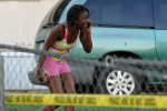 A woman reacts after receiving news that a loved one was killed during a shooting near a mobile home community on Athens east side behind the Airport Minit Market on Tuesday, Sept. 30, 2014, in Athens, Ga. (AP Photo/Athens Banner-Herald, AJ Reynolds)
