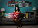 Beckie Clark poses for a photo with pillow covers she designed inside her home in Athens, Ga., Tuesday, July 2, 2013. (AJ Reynolds/The Athens Banner-Herald)