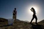 Muhammad Afzal Abdul, 48, left, watches the swing and form of a young student, right, at the Kabul Golf Club, Afghanistan's only course, on the western edge of Kabul on Friday Sept. 28, 2007. Abdul is the director of the golf course and resident golf pro. Having had his golf clubs and shop destroyed under the Communist regime, Abdul depends on donated golf clubs and balls to supply his players. After reopening in 2004, Abdul's hopes were high for money to develop his golf course, which is used mostly by foreign diplomats and aid workers. With larger concerns facing Afghanistan, like a resurgence of the Taliban and a failing economy, aid for a golf course appears long in coming.