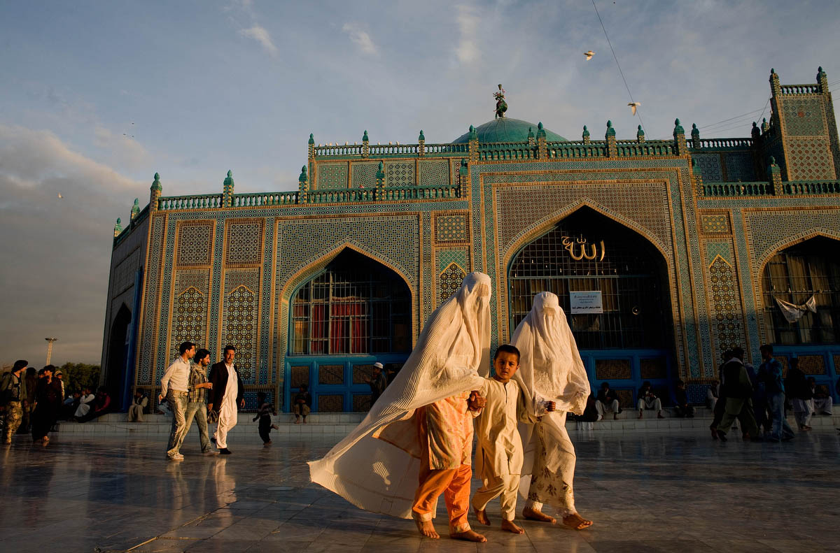 Families gather in the courtyard of the Shrine of Hazrat Ali during Mujahideen Day in Mazar-i-Sharif, Afghanistan on April 28, 2009. Mujahideen Day is the celebration of the fall in 1992 of the government installed by the departing Soviet forces.