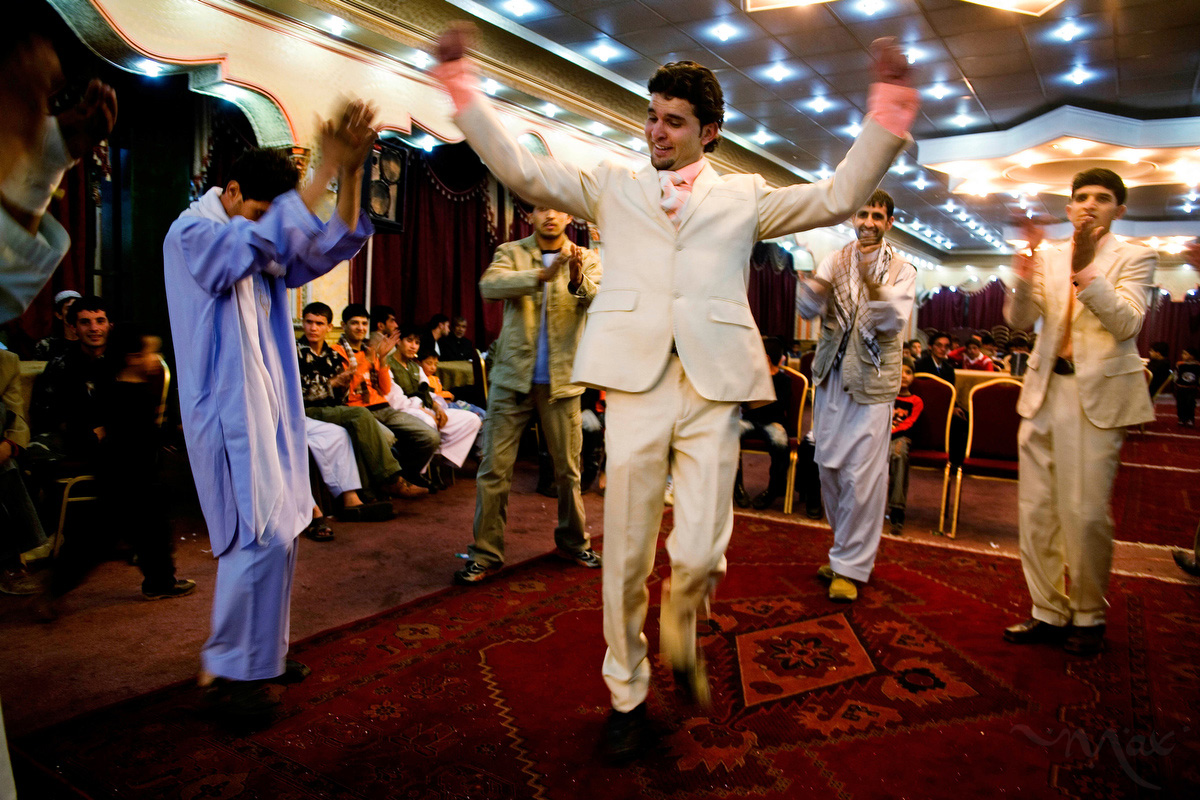 Azizi, the cousin of the groom, and fellow wedding revelers enjoy Panjshir dances called Parda Awal _ the first curtain _ and Dard-e-Dandon _ the toothache _ at the al Mase Sharqh wedding hall in Kabul, Afghanistan on Saturday October 20, 2007.
