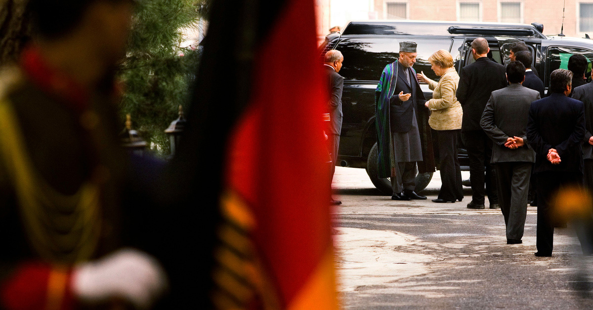German Chancellor Angela Merkel speaks with Afghan President Hamid Karzai as they arrive for a joint press conference at the palace in Kabul, Afghanistan on Saturday November 3, 2007. The German chancellor talked about the progress made in building schools for girls and her desire to strengthen her relationship with Afghanistan. The chancellor also visited Germany's 3,000 troops who are part of the NATO-led International Security Assistance Force. Germany has been criticized recently for keeping troops on relatively peaceful missions in the north of the country and not engaging in the antI-Taliban insurgency in the south of the country.