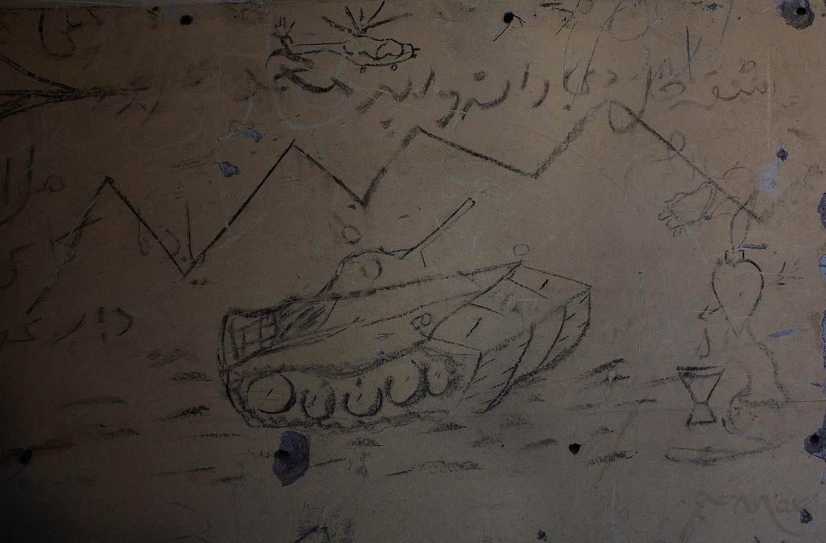 Graffiti depicting a fighting tank decorates the war-ravaged halls of the once grand Darulaman Palace. Once home to King Amannullah in the 1920's the palace was destroyed during the civil war after 1992. The palace sits as a reminder of Kabul's brutal past. Darulaman Palace is on the outskirts of Kabul, and once housed the king's defense ministry and justice ministry.