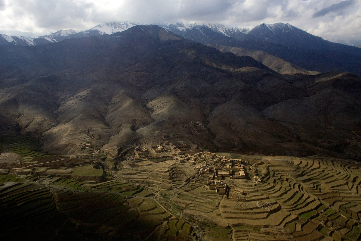 A medical evacuation helicopter travels over an agricultural village between Jalalabad and Bagram. Weather conditions in Afghanistan can quickly change, making rescues difficult. The rugged terrain and weather of Afghanistan has been a major challenge to the foreign militaries trying to fight the Taliban in Afghanistan.