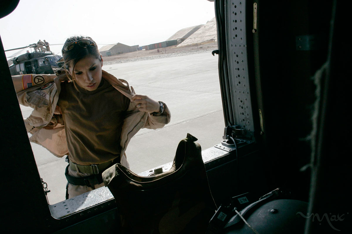 Specialist Elizabeth Shrode, a medic with the 54th Medical Evacuation unit, responds to a call to transport two wounded soldiers, from the location of an attack near Balad, to the Balad Theater Hospital. In preparation for the mission, Shrode dons her flight suit, bulletproof vest, and flight helmet. Nearing the end of a yearlong deployment, Shrode has flown hundreds of medical evacuation missions. The 54th Medical Evacuation unit responds to soldiers in central Iraq who need immediate medical evacuation and takes them directly to the largest and most advanced medical hospital in Iraq.