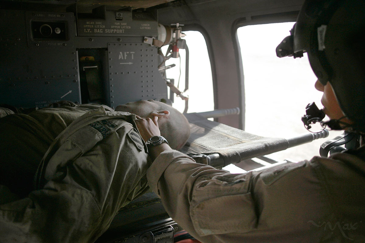 Specialist Elizabeth Shrode sees no signs of life as she choppers to the Balad Theater Medical Hospital.