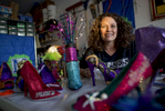 KENNER, LOUISIANA. Cari Rhoton, a lieutenant in an all-female Mardi Gras parade group known as the Krewe of Muses, creates the group's signature shoes from her garage in Kenner, La., Sunday, Jan. 10, 2016. Over 1000 members of the organization ride floats and pass out hand decorated shoes and other trinkets during Mardi Gras. (AP Photo/Max Becherer)
