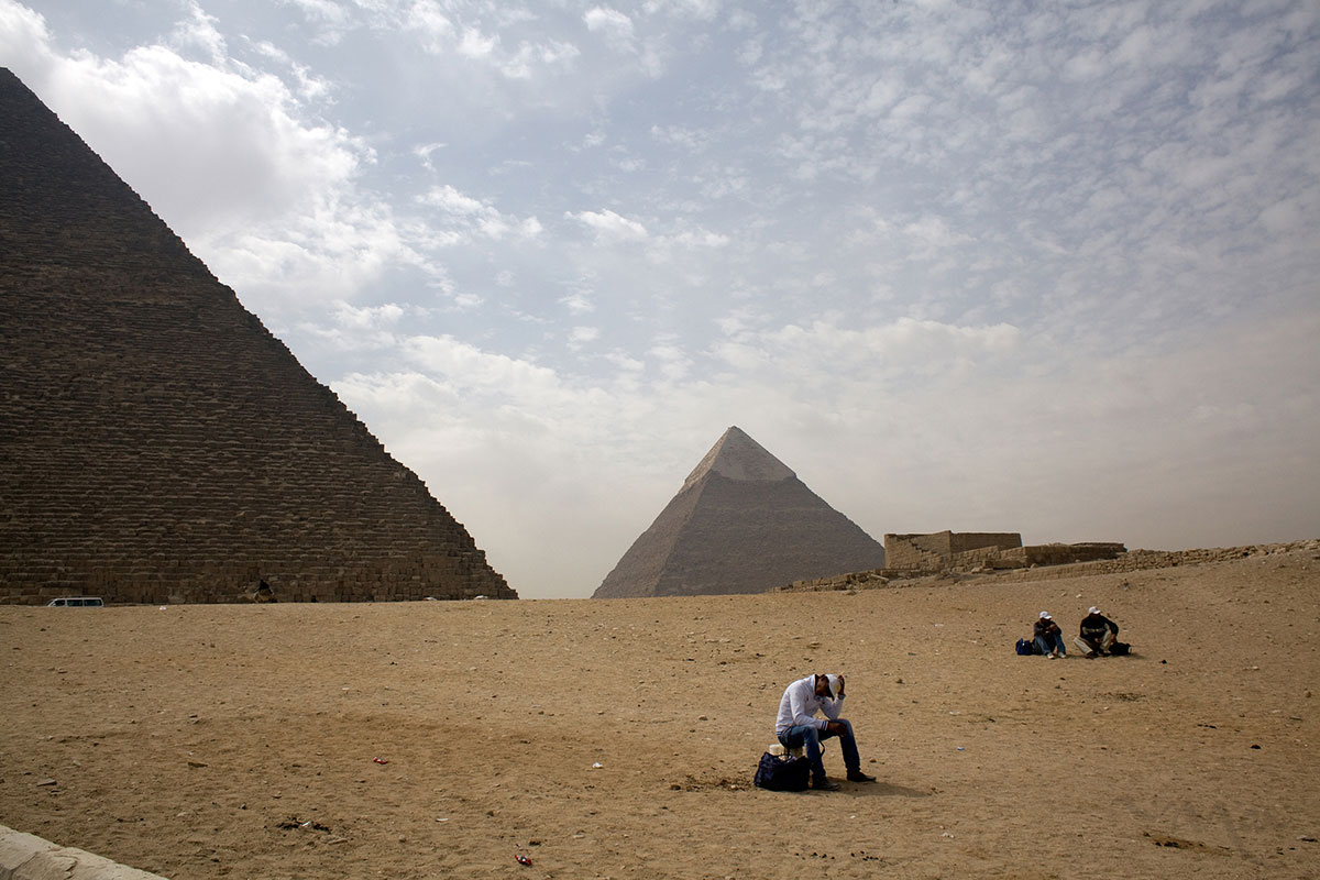 GIZA, EGYPT. Egyptian trinket sellers wait for tourists at the pyramids of Giza, in Cairo, Egypt on Sunday March 11, 2012. Egypt saw an 18 percent drop in tourist nights spent in the country in 2011 and the numbers have not improved in 2012 according to the United Nations World Tourism Organization, the premier tourism organization which participated in the ITB Berlin travel fare last week.