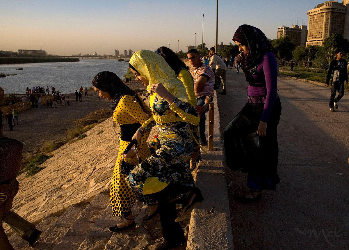 Dressed in their holiday best, Iraqis enjoy Abu Nuwas Park along the Tigris River in Baghdad during Eid Al-Fitr on October 3, 2008 in Baghdad, Iraq. Because of the improved security situation, Iraqis in large numbers were able to celebrate the Eid Al-Fitr holiday with family picnics and walks along the riverfront situated opposite the American Embassy and Iraqi government compound know as the Green Zone in Baghdad. Eid Al-Fitr marks the end of the Islamic holy month of Ramadan.
