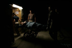 A wounded soldier is wheeled into the Air Force Theater Hospital, run by the 332nd Expeditionary Medical Group, at Balad Air Base, on October 30, 2005.