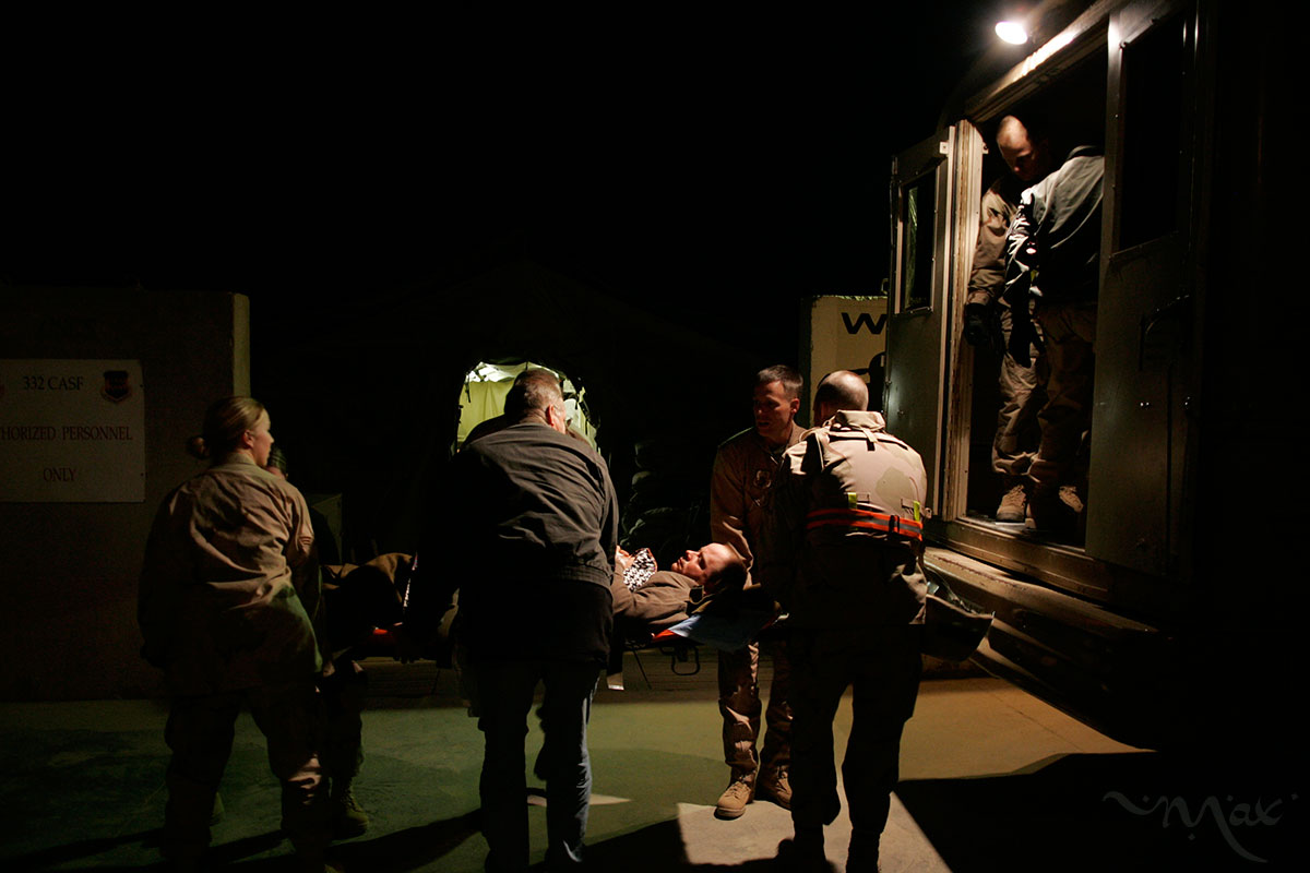Wounded are transported from the Contingency Aeromedical Staging Facility (CASF) at Baled Air Base to a bus which will transport them to a C-17 aircraft that will take them on a 5-hour flight to Germany. The CASF manages the movement of the full range of injured soldiers who have to be transported out of Iraq for care.
