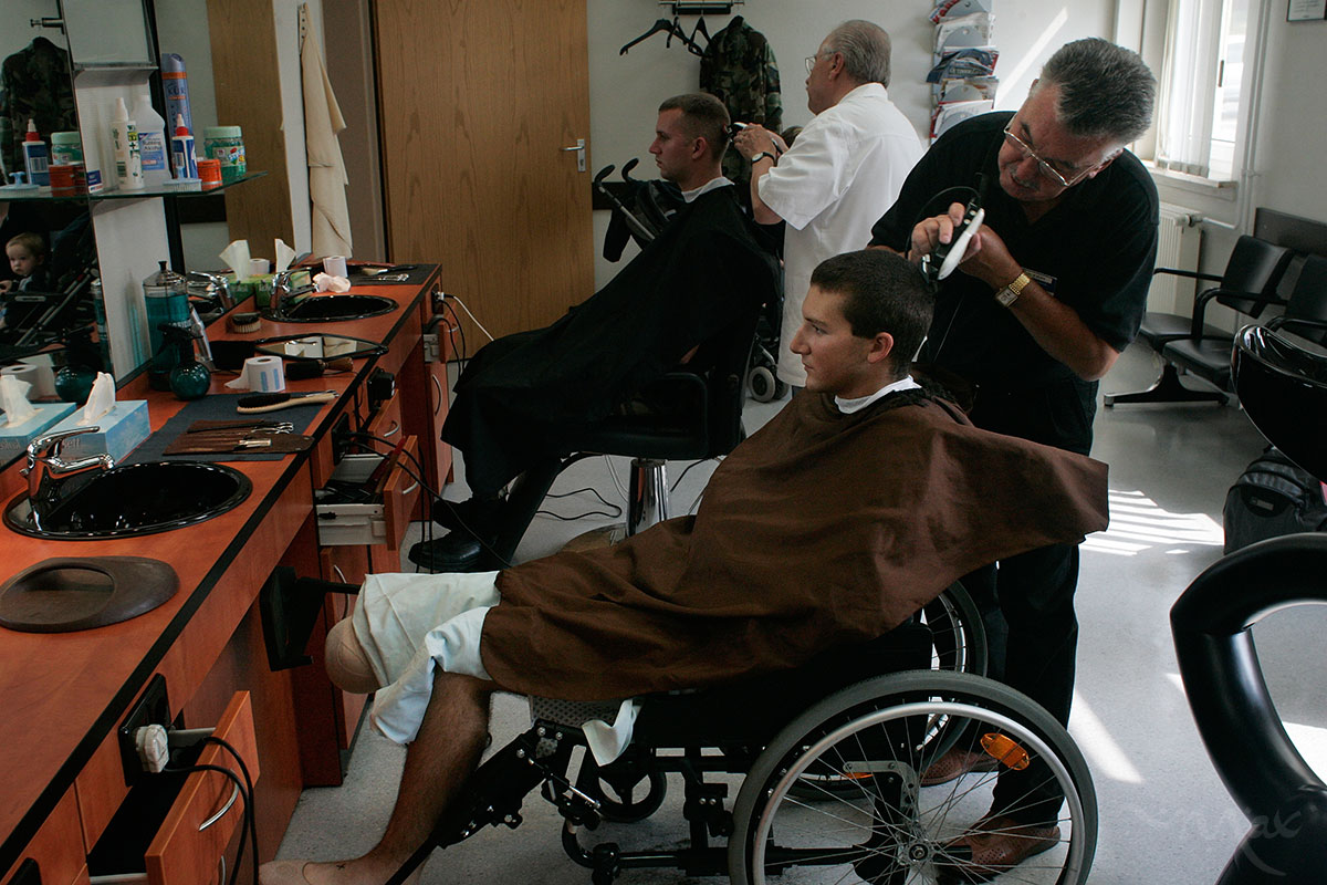 Four days after losing his leg from an improvised explosive device, Marine Lance Corporal Matthew Schilling gets a hair cut at the Landstuhl Regional Medical Center in Germany. After more stabilizing surgeries in Germany he will be flown to the United States where he will be fitted with a prosthetic limb.