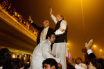 LAHORE, PAKSITAN. Former Prime Minister Nawaz Sharif, right, and his brother Shahbaz Sharif, left, stand on the top of a vehicle as they wave to hundreds of supporters after arriving at the Lahore Airport from Saudi Arabia on Sunday, November 25, 2007 in Lahore, Pakistan. President Pervez Musharrif sent Sharif and his brother into exile some eight years ago. He has arrived in Pakistan to head one of the country's leading opposition parties.