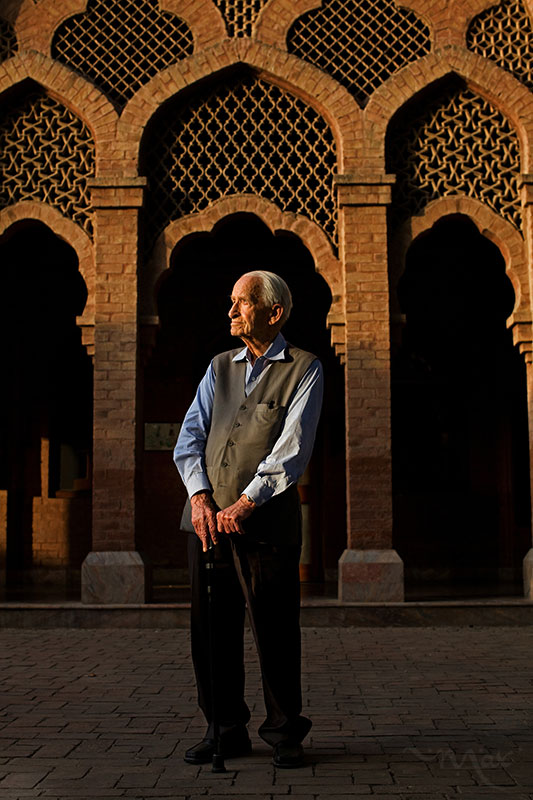 LAHORE, PAKISTAN. Geoffrey Langlands stands for a photo on the grounds of Aitchison College, a boarding school for boys in Lahore, Pakistan on Wednesday June 6, 2012. Langlands waded onto the shores of British India on a troop carrier in 1944 and now at age 94, finds himself near the end of a long career as an educator of some of Pakistan's best-known leaders. For the last 20 years Langlands has dedicated his teaching talents to establishing the Langlands School and College in Chitral, located at the base of the Hindu Kush mountains in Pakistan's Northwest Frontier province. In October of this year Langlands retired to a two-room apartment on the grounds of Aitchison College where he spent the middle 25 years of his career as a housemaster and headmaster. Langlands was housemaster of Kelly House, seen in the background, which is an Anglo-Mughal style boarding house on the Aitchison College grounds.