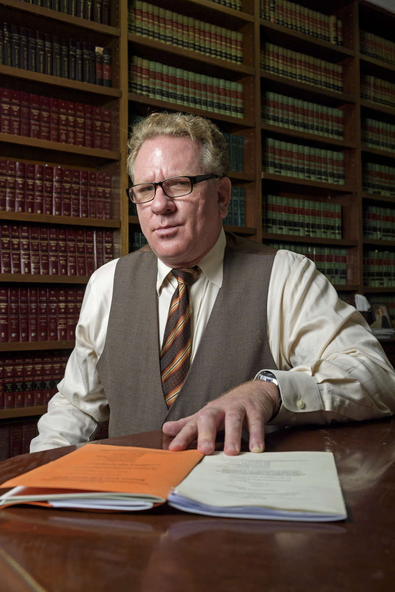Portraits included in non-unanimous jury project that was awarded the 2019 Pulitzer Prize for Local Reporting. Attorney Timothy Meche poses for a photo in the library of his law office in New Orleans, La., Friday, April 20, 2018. Meche has his hand on an amicus brief he filed with the U.S. Supreme Court in 2008 on behalf of the Louisiana Association of Criminal Defense Lawyers, highlighting the racist origins of the state's non-unanimous verdict law.