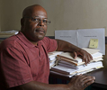 Portraits included in non-unanimous jury project that was awarded the 2019 Pulitzer Prize for Local Reporting. Calvin Duncan poses for a photo with two stacks of legal paperwork filed under {quote}Notification of Direct Appeal Decision{quote} and Non-unanimous Jury Verdict issues{quote} in his Central Business District office in New Orleans, La., Friday, Feb. 23, 2018. Duncan is a former Angola inmate who is pushing the United States Supreme Court, through repeated petitions on behalf of inmates convicted on non-unanimous jury counts, to overturn the state's unusual law allowing murder convictions of a 10 to 2 jury serious felony cases.