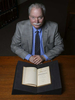 Portraits included in non-unanimous jury project that was awarded the 2019 Pulitzer Prize for Local Reporting. Leon Miller, the head of the Louisiana Research Collection, sits behind a copy of the Constitution of the State of Louisiana is photographed at the  in New Orleans, La., Tuesday, March 27, 2018.