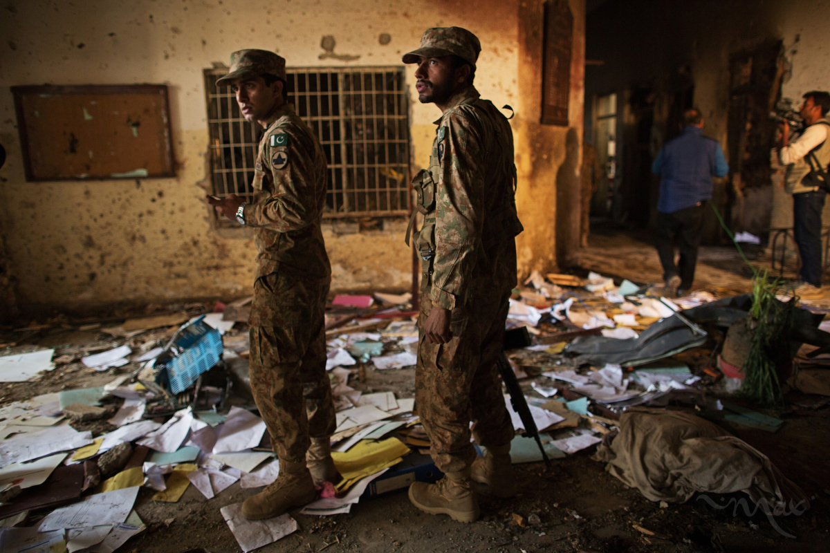 PESHAWAR, PAKISTAN. Pakistan Army soldiers inspect the damage done to the Army Public School and Degree College in Peshawar, Pakistan on Wednesday, December 17, 2014 where Taliban gunmen killed 150 people, many of them children, the day before. Empty bullet casings, pools of blood and personal belongings littered the floors.