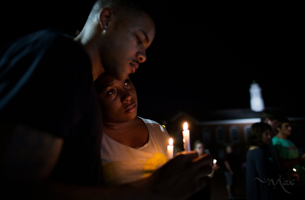 LAFAYETTE, LOUISIANA. Students from the University of Louisiana at Lafayette including Sheldon Gilton, left, and Brea Butler, gathered for a candle light vigil to honor those killed and wounded in a gun attack at a popular movie theater the day before in Lafayette, Louisiana. The gunman took his own life after killing two and wounding nine.  (Max Becherer/Polaris)