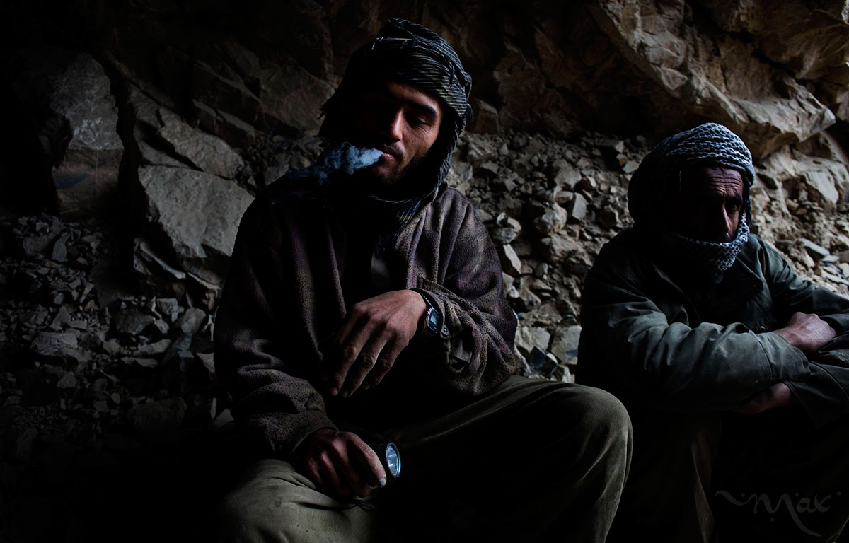 After setting off dynamite charges in the mine Rahimullah, 27, takes a smoke break as he waits for the dust to clear the shaft of a mineral mine on the slope of the Hindu Kush mountains over the Panjshir Valley near the village of Khenj, in Afghanistan on Thursday, October 25, 2007.  Rahimullah is a hired hand who works for a team of young men who blast and drill holes in the mountains looking for emeralds and precious stones. The young men who work the mines were boys when the Taliban fell six years ago. The mines were a way to fund the jehad most of their father's participated in but now the young men dig, hoping to find a rock large enough to feed their families or to give them enough money to escape the work of the mines.