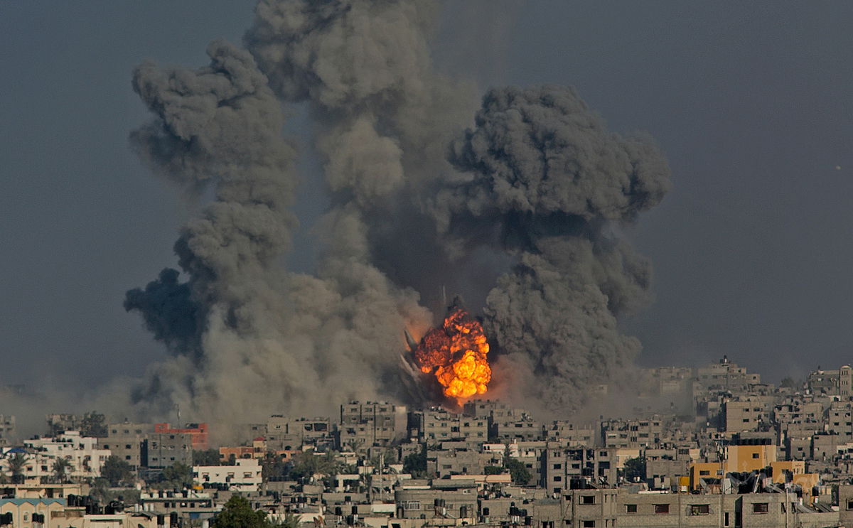 GAZA CITY, GAZA STRIP. Explosions caused by Israeli airstrikes erupt in the Jabal al-Rayyes neighborhood of Gaza City in the Gaza Strip on July 29, 2014. Israel said they were targeting 32 tunnels dug to allow Hamas militants to go under the border fence and infiltrate Israel.