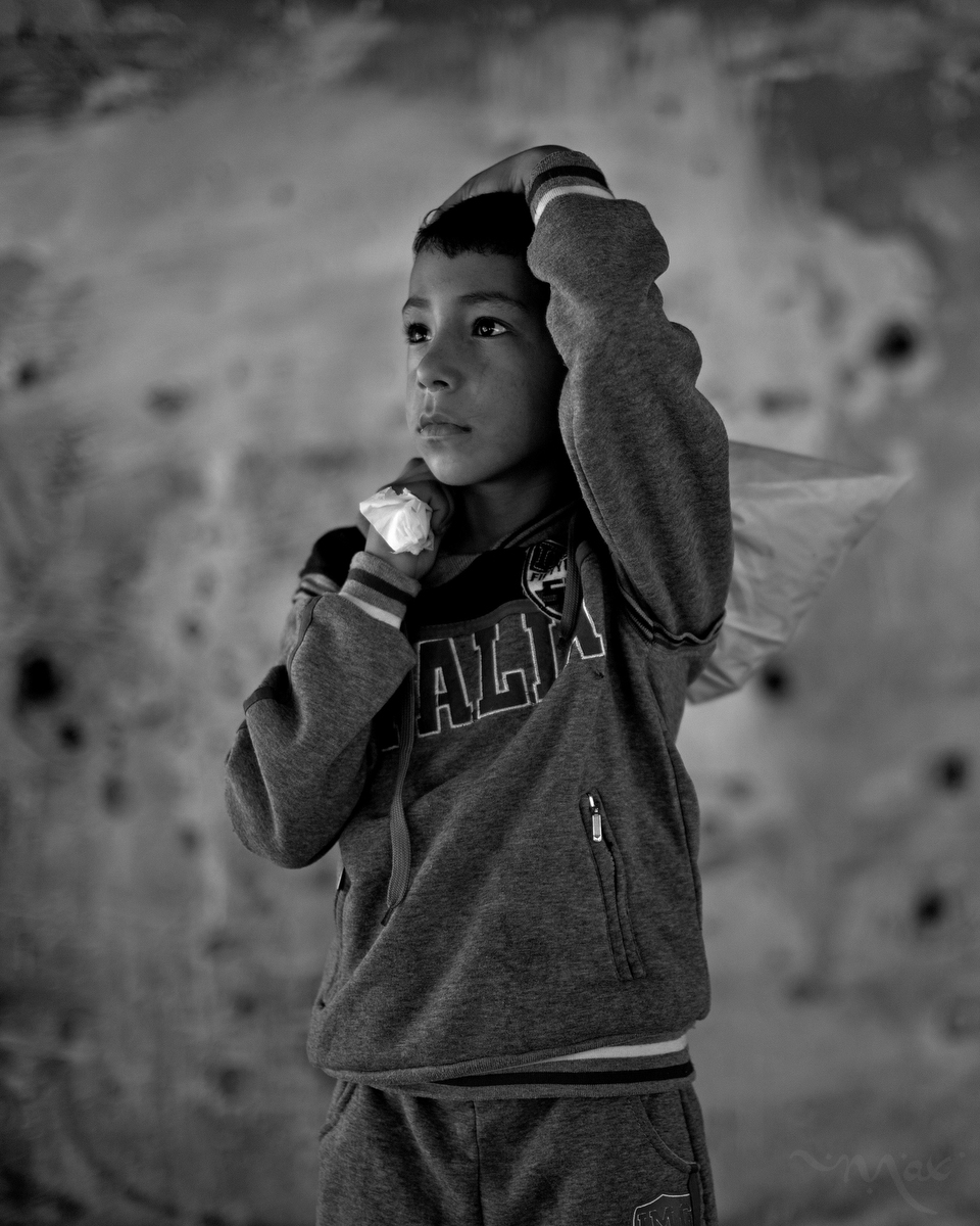 "GAZA STRIP. Hafez Abbas, 9, stands in a destroyed building in the Beit Hanun neighborhood of the Gaza Strip on Tuesday, October 28, 2014.    Hafez Abbas, age 9 - Beit Hanun, Gaza Strip. ""We had a very beautiful garden but it was totally demolished, I swear it was very beautiful. The IDF (Israeli Defense Force) called us so many times telling us to leave our house. We refused to evacuate the house but finally we had to leave and they totally destroyed it. We relocated to a UN school but it was bad. We had no water to drink. I am just now coming from my uncle's house that was demolished by the IDF. I went to get some of my things from under the rubble but we found nothing, even the door disappeared."""