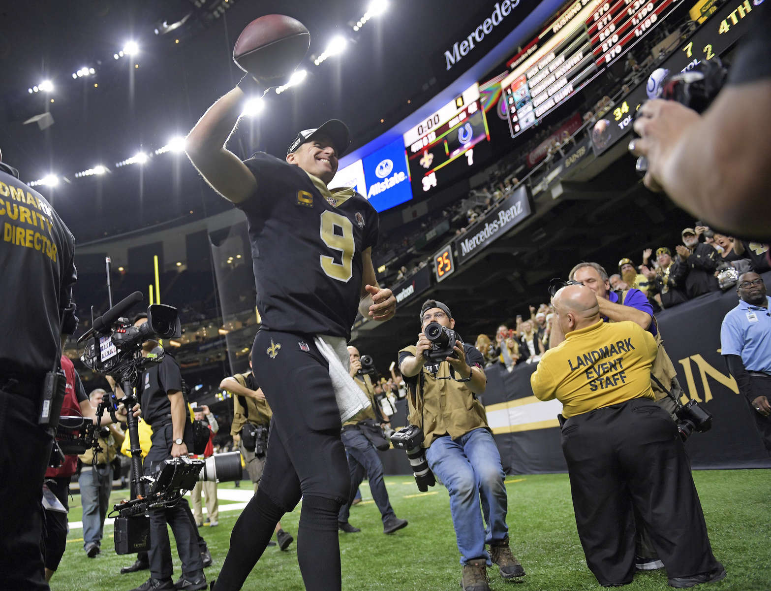 New Orleans Saints quarterback Drew Brees (9) leaves the dome after the game as he celebrates breaking the NFL record for career passing touchdowns of 539, set by Peyton Manning, in the second half of an NFL football game against the Indianapolis Colts in New Orleans, Monday, Dec. 16, 2019.
