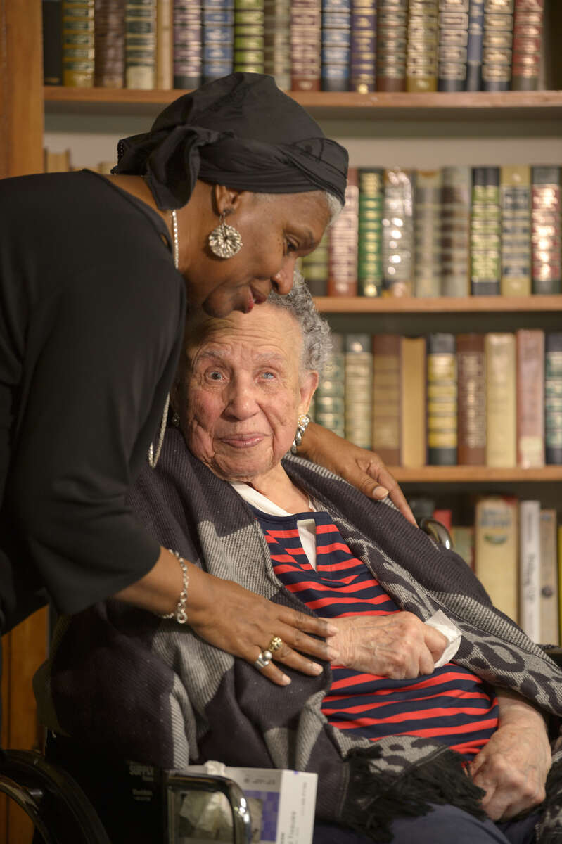 Sharon Gautreaux hugs Leonora Barnett, who Gautreaux had as her second grade teacher, as Barnett celebrates her 102nd birthday at Covenant Nursing Home in New Orleans, La. Wednesday, Nov. 27, 2019. On her birthday Barnett was honored by NOLA Public Schools Superintendent of Schools Dr. Henderson Lewis Jr. as well as city and state officials for a life dedicated to public education. Barnett taught at McDonogh 24 for over 40 years.