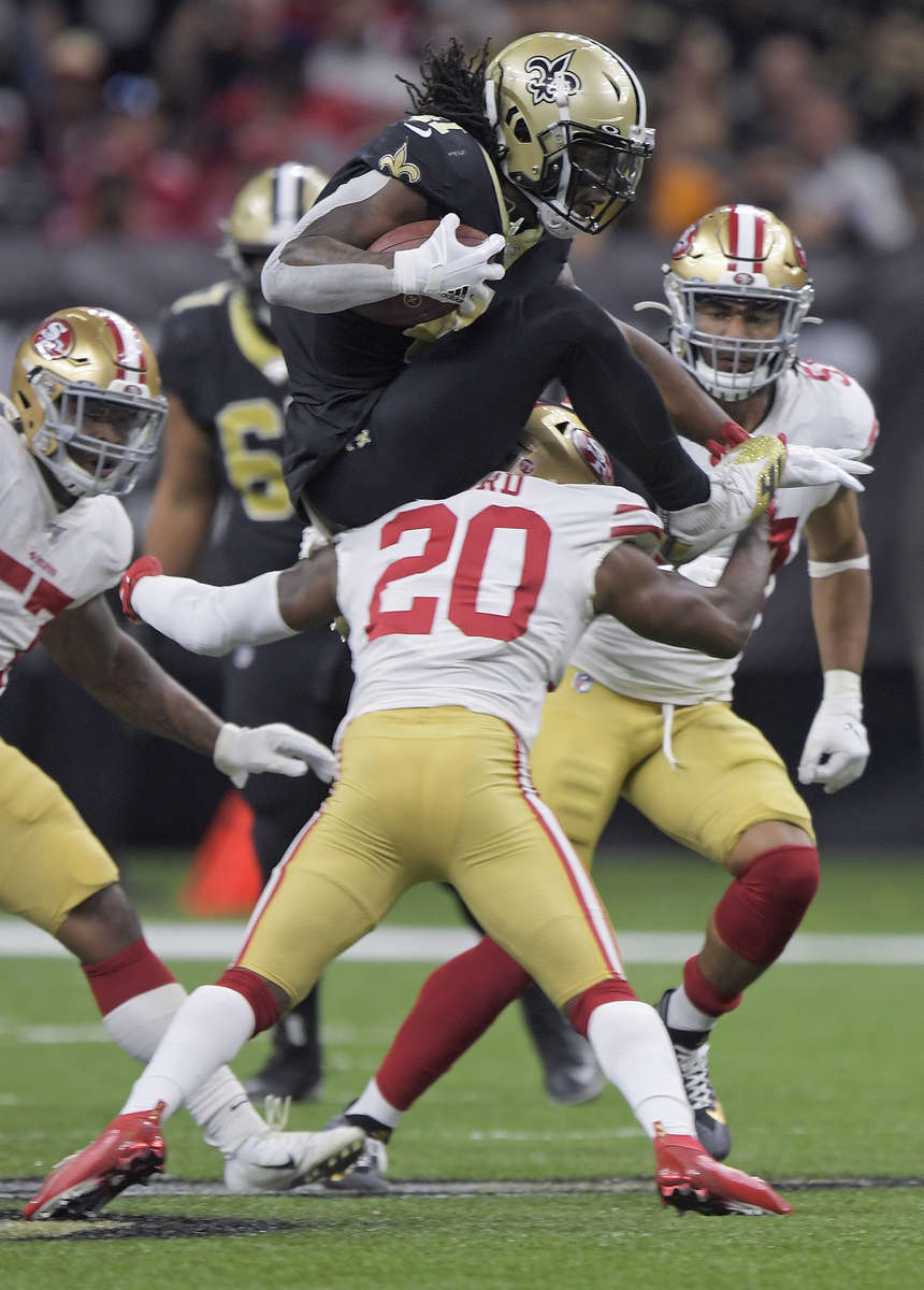 New Orleans Saints running back Alvin Kamara (41) jumps over San Francisco 49ers free safety Jimmie Ward (20) during the first half of an NFL football game in New Orleans, Sunday, Dec. 8, 2019. The San Francisco 49ers won 48-46.
