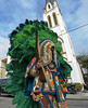 Spyboy Samual Fields of the Uptown Warriors holds a SKS, a semi-automatic carbine, with an extended bayonet as he looks for other Indians to challenge with tribal dances and chants in Central City on Mardi Gras day in New Orleans, La., Tuesday, Feb. 13, 2018. Mardi Gras Indian tribes who wear hand-made one of a kind costumes meet other tribes and perform ritual dances and chants all over the city on Mardi Gras Day.