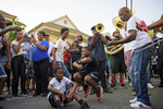 The Big 6 Brass Band leads a second line past Dooky Chase restaurant to celebrate the life and legacy of the legendary New Orleans chef Leah Chase in New Orleans, La. Monday, June 3, 2019.