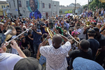 Trumpeter James Andrews leads a second line for Malcolm {quote}Dr. John{quote} Rebennack, who died Thursday at age 77, as it pauses in front of a mural of Allen Toussaint on Claiborne Ave. in the Treme in New Orleans, La. Friday, June 7, 2019.