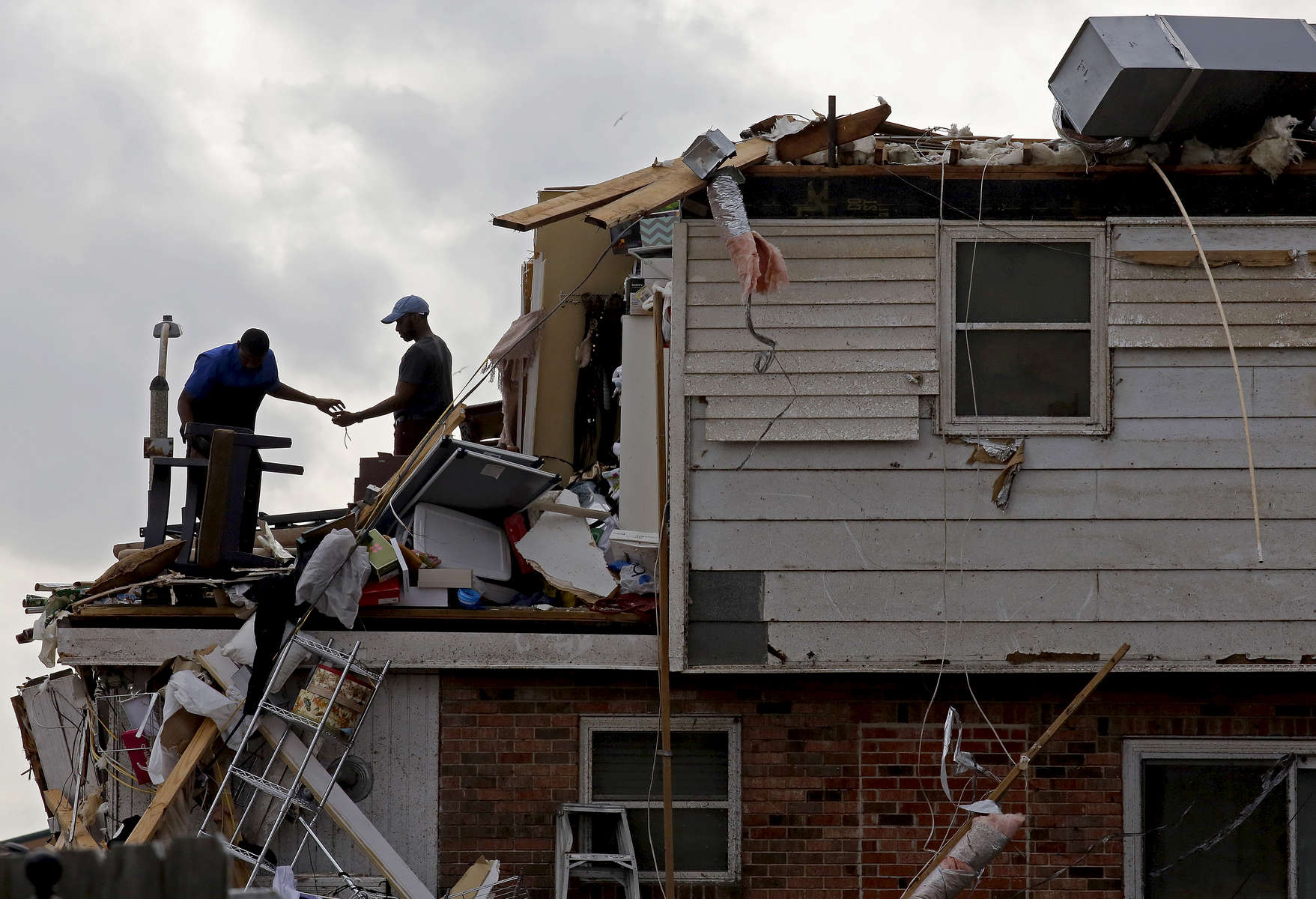 NEW ORLEANS, LOUISIANA. Personal belongings are salvaged from a tornado damaged home in eastern New Orleans, Louisiana after a tornado touched down leaving many homeless on Tuesday, February 7, 2017. (Max Becherer/Polaris Images)