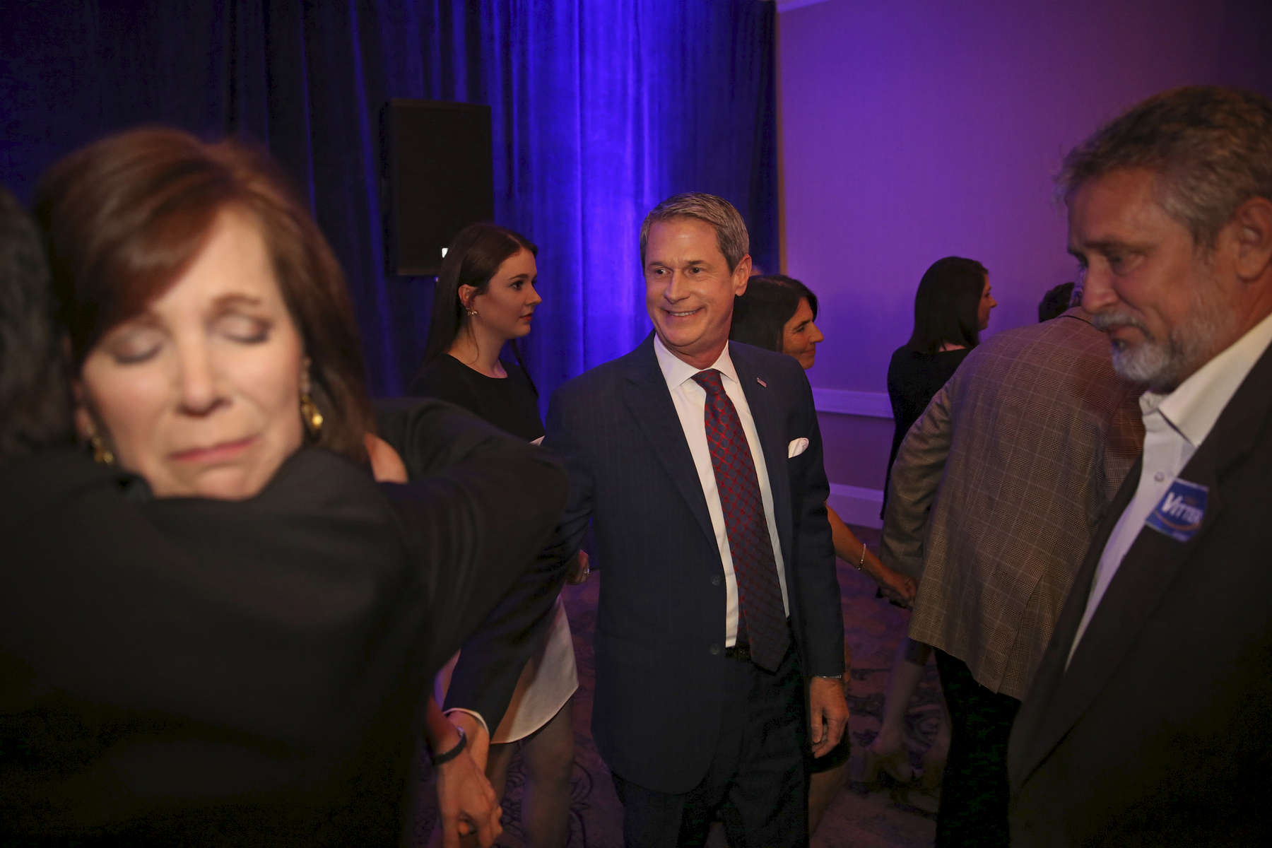 KENNER, LOUISIANA. Louisiana gubernatorial candidate, Sen. David Vitter, R-La., and his wife Wendy are comforted by their supporters after announcing his defeat at his election night watch party in Kenner, La., Saturday, Nov. 21, 2015. (AP Photo/Max Becherer )