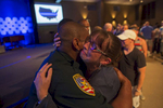 "East Baton Rouge Sheriff officer Eddie Guidry, left, is hugged by a teary Terri Carney, both members of The Rock Church on the outskirts of Baton Rouge, during a prayer vigil for the officers killed and wounded by a gunman on Sunday in Zachary, La. USA, Monday, July 18, 2016. About 100 people came to the special hour-long prayer vigil. Col. Michael Edmonson, superintendent of the Louisiana State Police, said at a news conference that day: ""There is no doubt whatsoever that these officers were intentionally targeted and assassinated.{quote} (AP Photo/Max Becherer)"