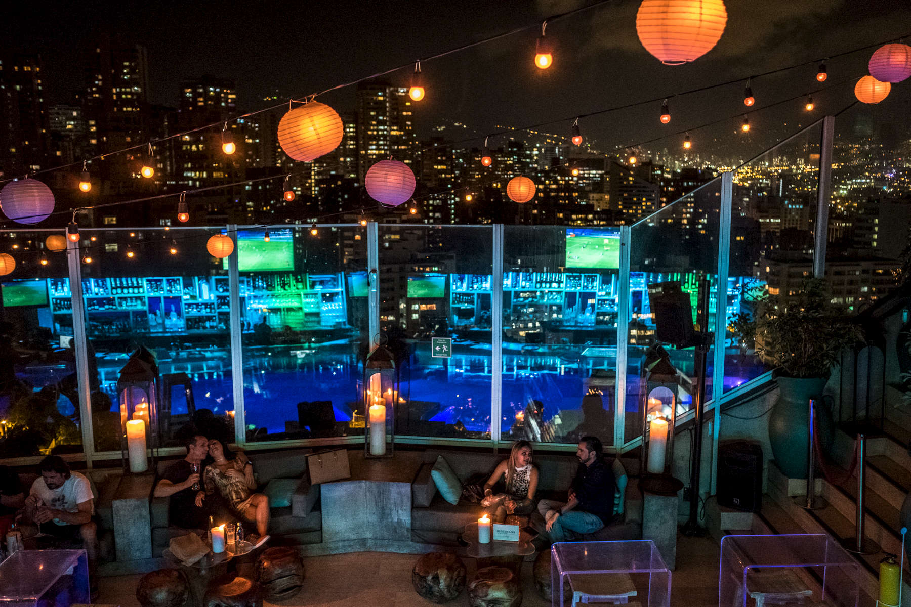 August 10, 2017. Medellin, Antioquia, Colombia. Visitors enjoy the panoramic view at the roof top of Charley Hotel located in the exclusive neighborhood of El Poblado in Medellin.