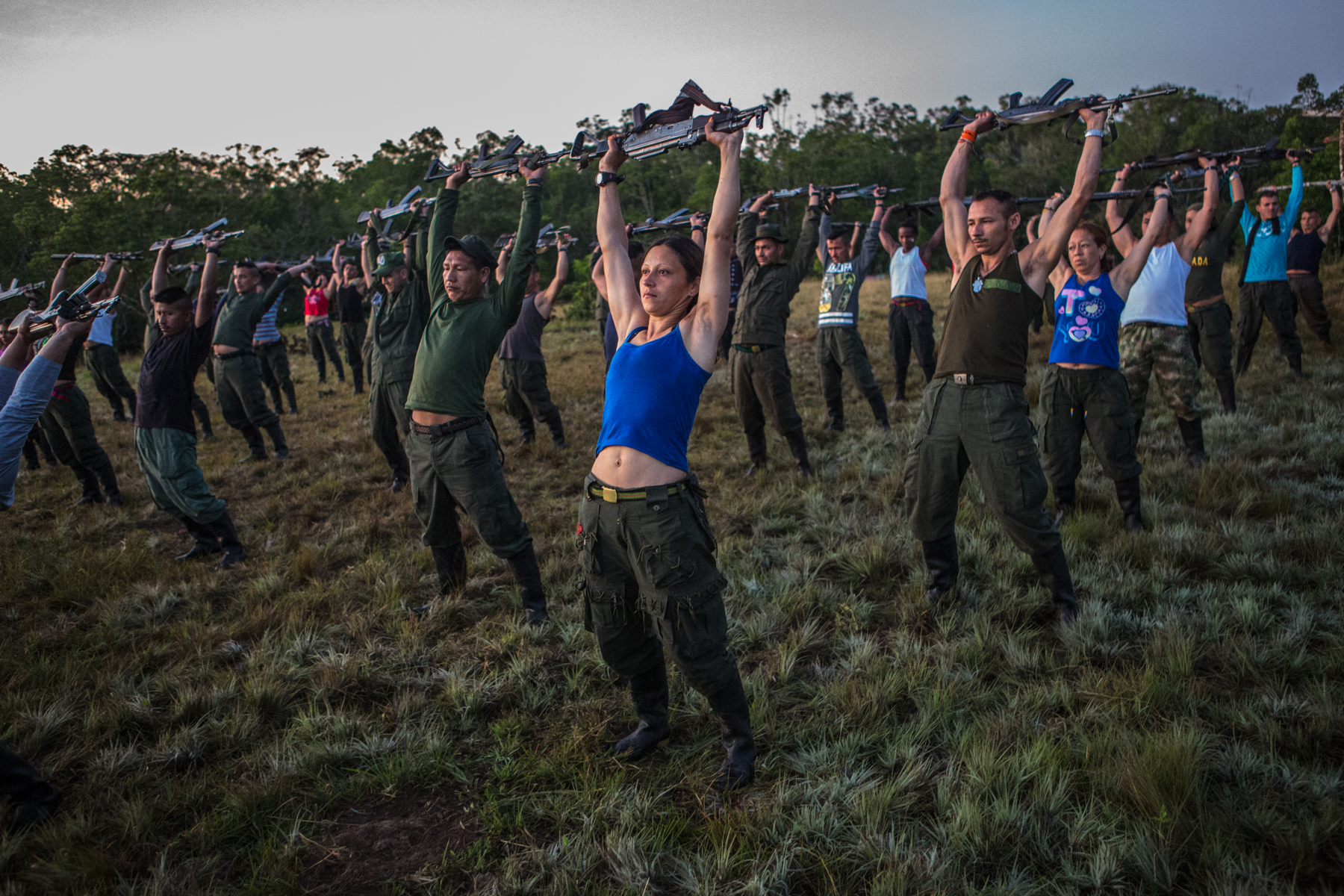 November 2, 2016. Members of the 17th and 51th fronts of FARC due military kynestethics every morning to main fitness.  After a referendum held on October 2 voted no against the peace accords, FARC troops have been held on standby waiting to reach a new peace agreement and proceed to concentration areas were they will demobilized in six months time. Caquetá. Colombia.