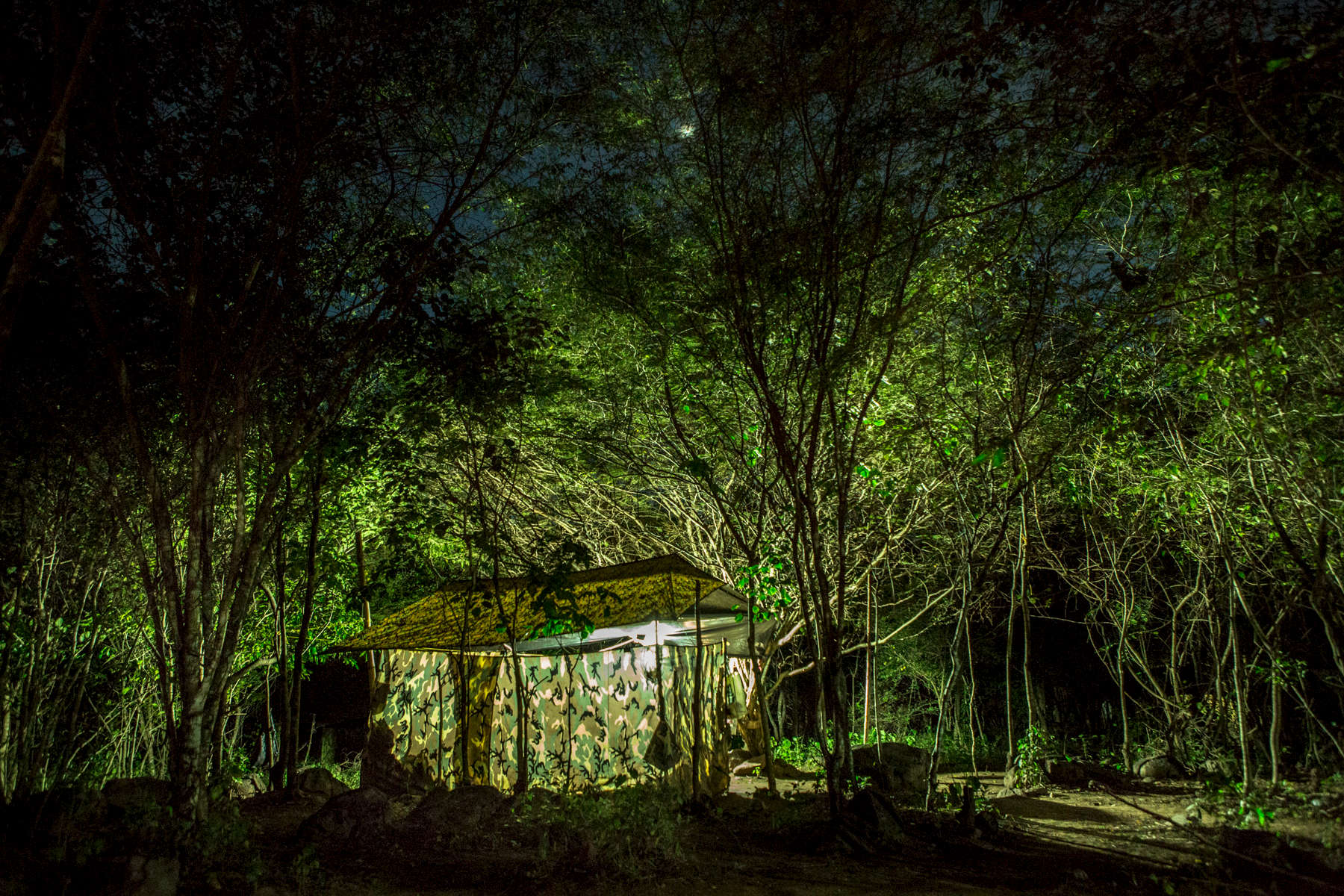 December 12, 2016. A tent in the camp of the 19th front of FARC illuminates its surrounding in the mountains on the border of Venezuela and Colombia.