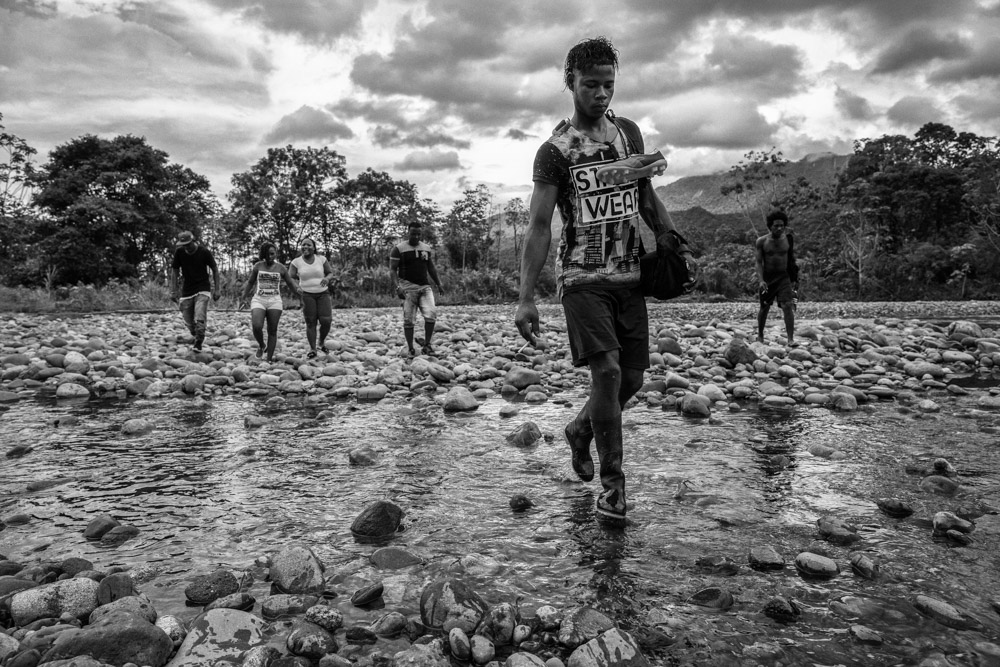 September 16, 2017. River Acari, Choco Colombia. Kleider Palma (23) navigate on boat along the Acari river with his fellow members of the 34th front of FARC Vegaez, Antioquia. An hour ride to be able to play soccer with local residents and with the 94th infantry Battalion of the Colombian Armed forces. Kleider joined FARC at the of 18 after the group visited his village he was recruited with his cousin. He always wanted to be a professional player but never had the chance to. After FARC signed a peace agreement with the Colombian Government around 7,000 members disarmed and were settled in 26 transitional zones around the country. Part of the reintegration and a way to win hearts and mind, FARC is beating on forming a professional soccer team. For now FARC teams play against local communities as they wait for assistance from the Government's sports agency Coldeportes and start a talent program that can foster players for a professional team.