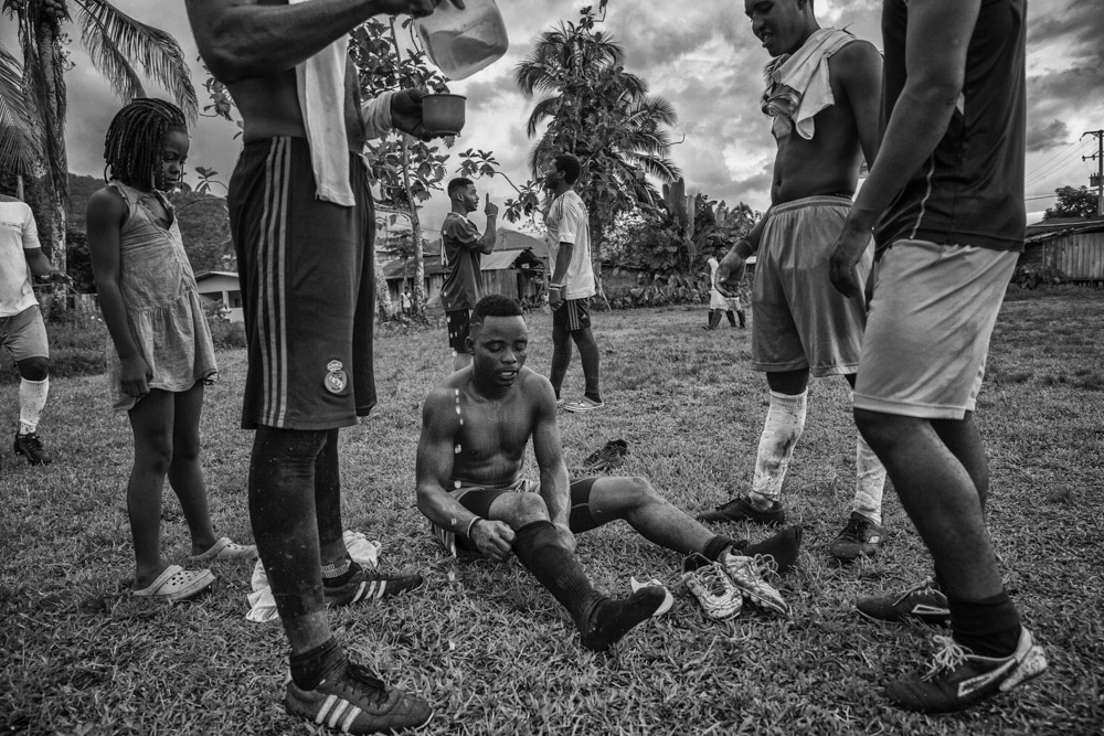 September 16, 2017. Vegaez, Antioquia, Colombia. Members of FARC soccer team share strategies before the next match against the 94th infantry Battalion of the Colombian Armed forces.. weekend the FARC soccer team travel by boat to the community of Vegaez to play friendly games against local teams. According to Walter Mendoza the leader in charge of soccer FARC program across all the 26 transitional zones, the idea is to start winning hearts and minds through sports. This not only helps out members take part in sports, which has always been at the core of FARC but to have exchanges with the communities. This is the only way for us to continue the work now that we have become a political party.""