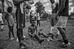 """September 16, 2017. Vegaez, Antioquia, Colombia. Members of FARC soccer team share strategies before the next match against the 94th infantry Battalion of the Colombian Armed forces.. weekend the FARC soccer team travel by boat to the community of Vegaez to play friendly games against local teams. According to Walter Mendoza the leader in charge of soccer FARC program across all the 26 transitional zones, the idea is to start winning hearts and minds through sports. This not only helps out members take part in sports, which has always been at the core of FARC but to have exchanges with the communities. This is the only way for us to continue the work now that we have become a political party."""""""