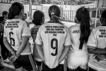 "September 25, 2017. La Elvira, Cauca, Colombia. The back of s shirt reads ""I only pray to God that the times to come will bring peace"" of one of the members of the members of the team from the nearby villages La Esperanza (in pink) as they gather to hear the referee of the tournament."