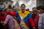 Venezuela´s interim president NicolásMaduro greeting a group of supports after announcing his candidacy for president at a rally in Caracas. March 11, 2013.