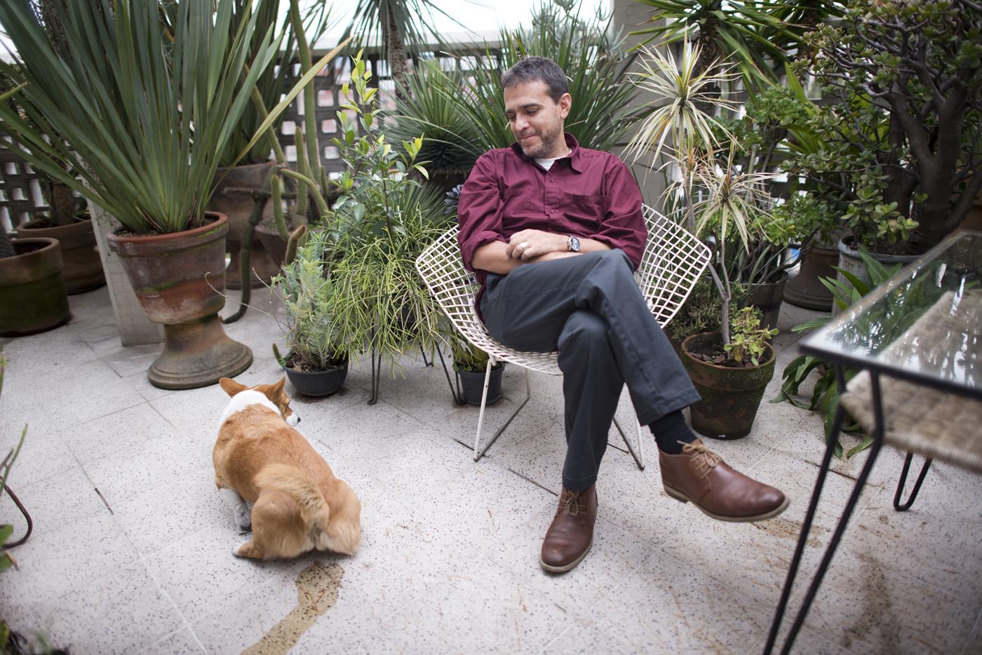 Artist and filmmaker Rafael Ortega, on his balcony in Progreso and Prosperidad, Escandon, Mexico City